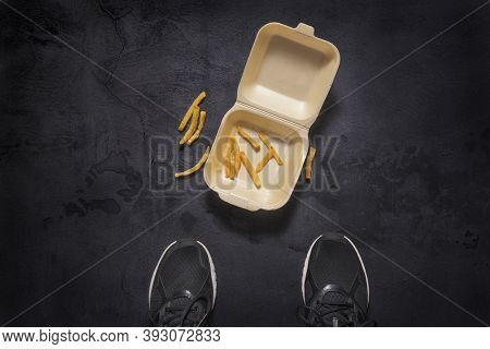 Stop Eating Junk Food. Sport Man Dropped French Fries In The Street.