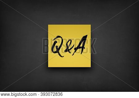 Questions And Answers Sticky Note On A Black Blackboard Background