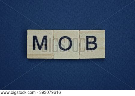 Gray Word Mob From Small Wooden Letters On A Black Table