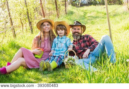 Rest Stop. Happy Family Rest On Green Grass. Spring Rest And Recreation Break. Fresh Air. Spending T