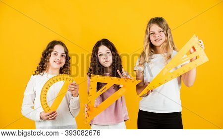 Smart And Confident. Exact Sciences. Three Girls With Protractor And Triangle Ruler. Back To School.