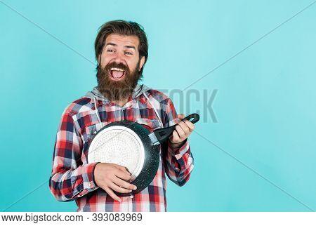 Cooking Utensils Vessels. Kitchen Advertising. Man With Saucepan. Man Hold New Brand Pan. Shopping K
