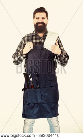 Barbecue Season. Bearded Hipster Wear Apron For Barbecue. Roasting And Grilling Food. Tips For Cooki