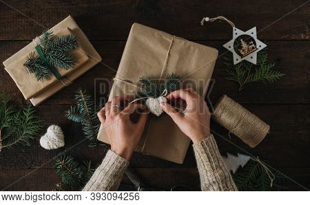 Giving Tuesday, Give, Help, Donation, Support, Volunteer Concept With Female Hands Wrapping Craft Gi