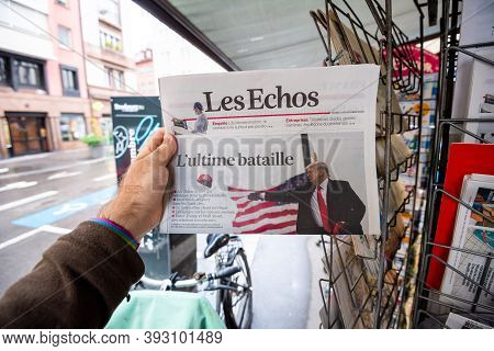 Paris, France - Nov 3, 2020: Pov Male Hand At The Newspaper Les Echos With Cover Featuring Final Day
