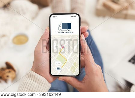 Modern Courier Delivery At Home, Shopogolic And Online Shopping. Hands Of Lady Holding Smartphone Wi