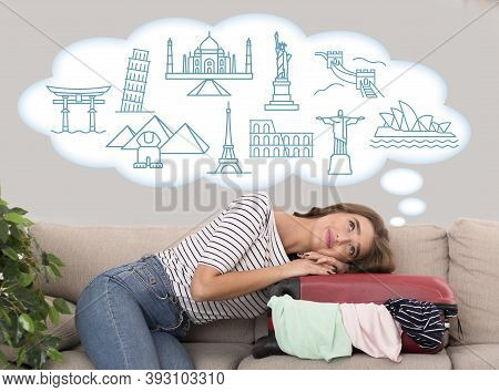 Dream Vacation. Traveler Girl Lying On Suitcase Dreaming About Travel And World Famous Sights Indoor