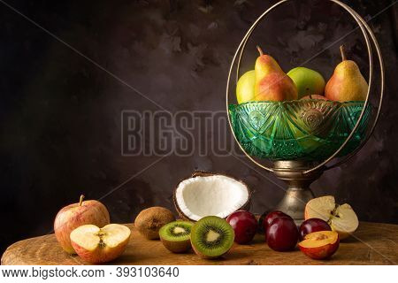 Arrangement Of Fruits In An Old Fruit Bowl On Rustic Wood With Spotted Background, Selective Focus.