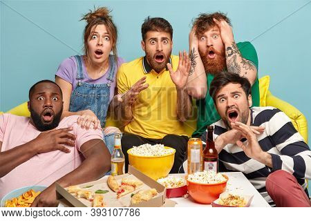 Scared Group Of Friends Watch Horror Movie, Feel Great Fear And Surprise During Thrilled Scary Film