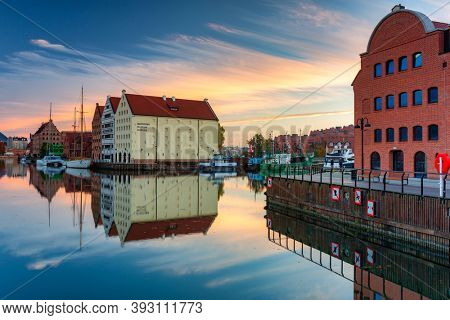 Gdansk - October 31, 2020: Gdansk with beautiful old town over Motlawa river at sunrise, Poland.