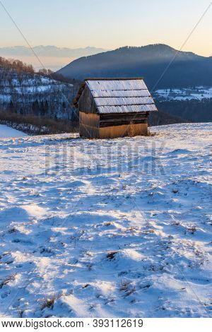 Winter landscape with hayloft in Velka Fatra, Slovakia