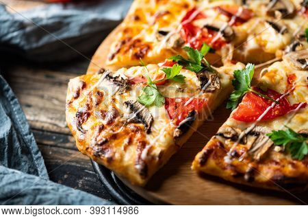 Tasty Juicy Pizza On Wooden Background. Lots Of Meat And Cheese. Mushroom Pizza. Pepperoni Pizza. Mo