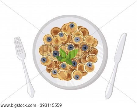 Mini Pancake Flakes With Butter And Blueberry For Breakfast On The Table. Tiny Pancakes, A New Food