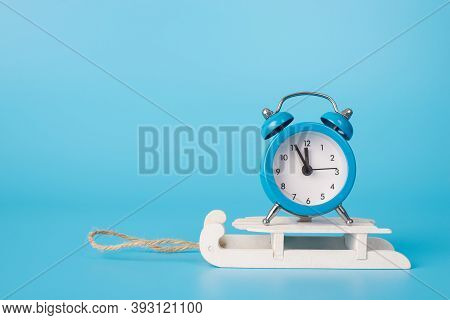 Five Minutes Before New Year Concept. Close Up Photo Of Small Toy Miniature Clock Showing Time To Mi