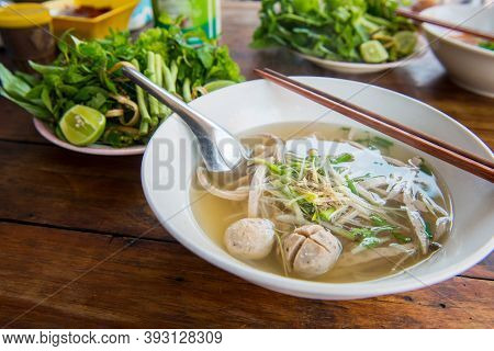 Close Up Of Pho Noodle Soup In Restaurant In Luang Prabang, Laos.  Pho Is Traditional Vietnamese Noo