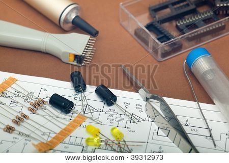 Detail of electronic components in brown background poster