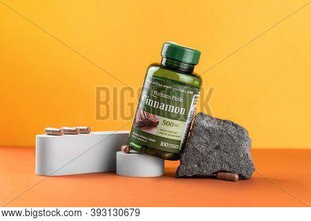 Poltava, Ukraine - November 2020 Cinnamon Supplements From Iherb Website On Yellow Background