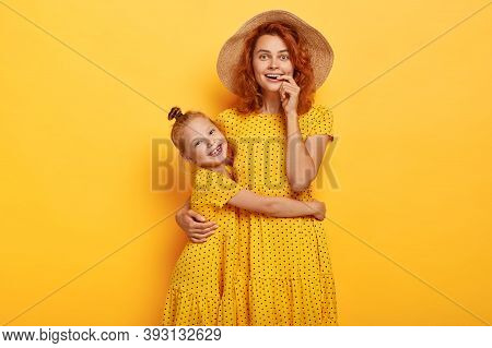 Happy Ginger Mommy And Daughter Embrace, Wears Same Polka Dot Dresses, Enjoy Summer, Spend Free Time