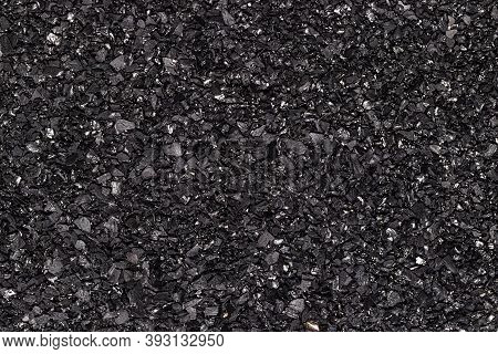 Close-up Activated Carbon Texture. Coconut Charcoal Background.