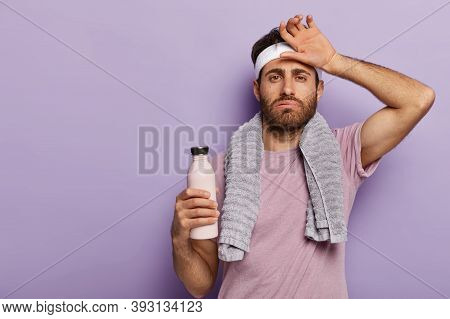 Tired Sportsman Sighs From Tiredness, Wipes Sweat From Forehead, Drinks Cold Water, Uses Towel, Has