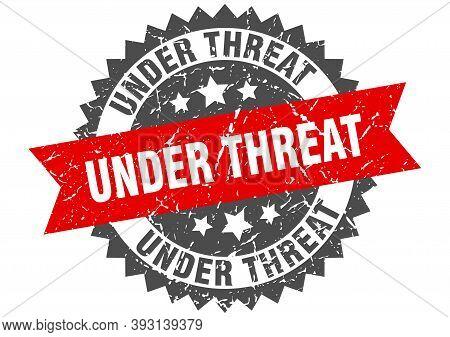Under Threat Stamp. Grunge Round Sign With Ribbon