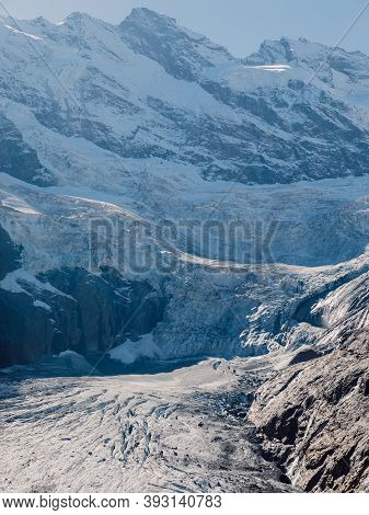 Rocky Mountains And Glacier. Peak Of Mountain And Ice Glacier In Dombay