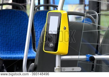 Vertical Handrail With Bus Payment Terminal In Passenger Compartment. Terminal For Contactless Payme