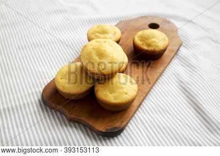 Homemade Cornbread Muffins On A Rustic Wooden Board, Low Angle View.