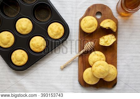 Homemade Cornbread Muffins On A Rustic Wooden Board, Top View. Flat Lay, Overhead, From Above.
