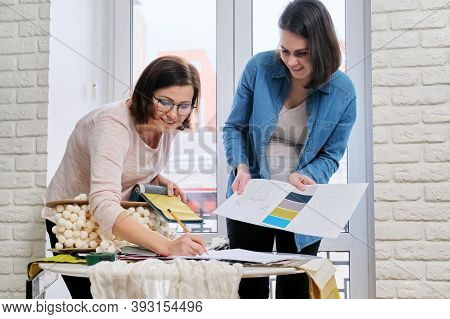 Interior Design, Two Working Colleagues Designers, Or Decorator And Client Choosing Curtain Fabrics,