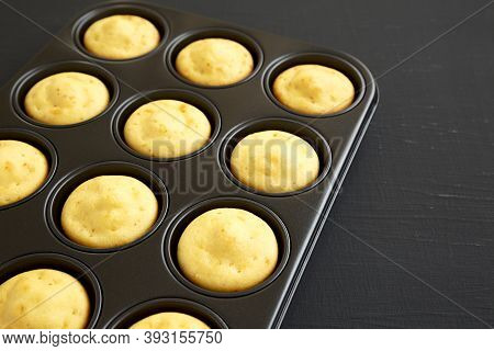 Homemade Cornbread Muffins On A Black Background, Side View. Copy Space.