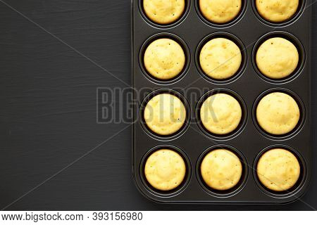 Homemade Cornbread Muffins On A Black Background, Top View. Flat Lay, Overhead, From Above. Copy Spa