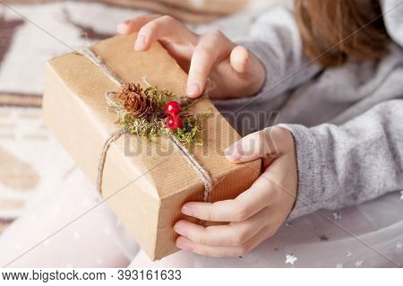 Girl's Hands Holding Gift Box. Copy Space. Christmas, Hew Year, Birthday Concept.