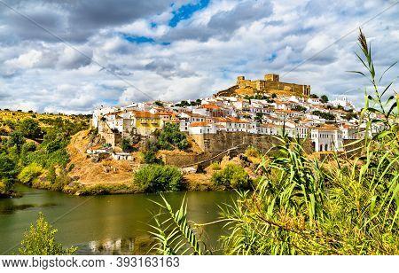 Mertola Town Above The Guadiana River In Alentejo, Portugal