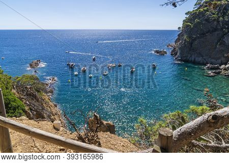 View Of Several Boats With Anchor Dropped In Pedrosa Cove In Llafranc, Girona, Catalonia, Spain.