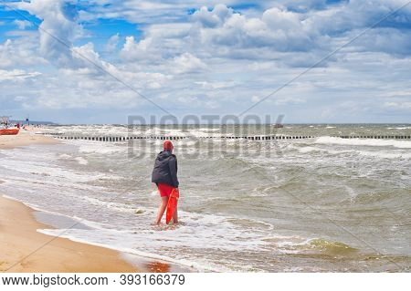Lifeguard Standing And Watching People In The Water. Poland