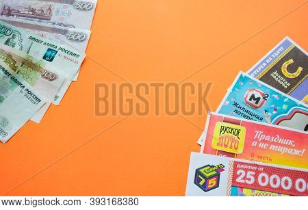 Moscow, Russia, July 2020: Various Russian Lottery Tickets On The Right, Several Different Russian R