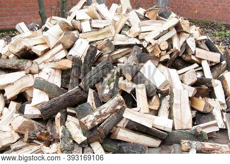 Heap Of Chopped Firewood. Pile Of Split Firewood. Stack Of Fuel Wood