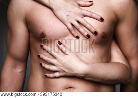 Embracing Couple, Female Manicured Hands Hugging A Muscular Male Torso. Naked Man And Woman, Passion