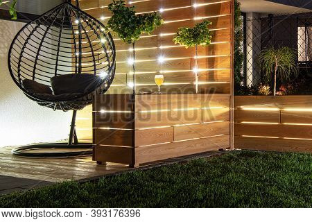 Residential Backyard Garden Wooden Recreation Place Deck With Table Illuminated By Led Outdoor Light