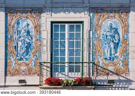 Details Of The Tiles With Religious Symbols Of The City Hall Of Cascais, In Portugal