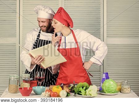Couple In Love Cooking Healthy Recipe. Amateur Cook Read Book Recipes. Improve Cooking Skill. Book R