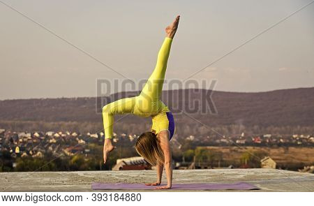 Gymnastics Athlete. It Never Gets Easier. Flexible Girl Outdoor. Woman Practicing Yoga. Stretching M