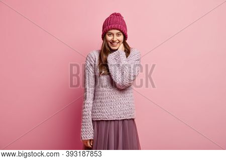 Good Emotions Concept. Pleased Lovely Female Model Looks Happily At Camera, Satisfied With Nice Comm
