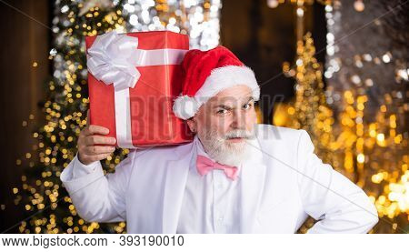Bearded Grandfather Man Celebrate Christmas. Christmas Party. Senior Man With Beard. Christmas Gift.