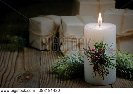 Christmas Eve. Natural Decor And Burning Candle On An Old Table. Country Style. Traditional Christma