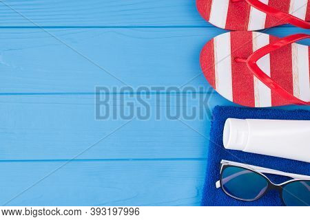 Summer Vacation Concept. Top Above Overhead View Close-up Photo Of Towel Sunglass Sunscreen And Flip