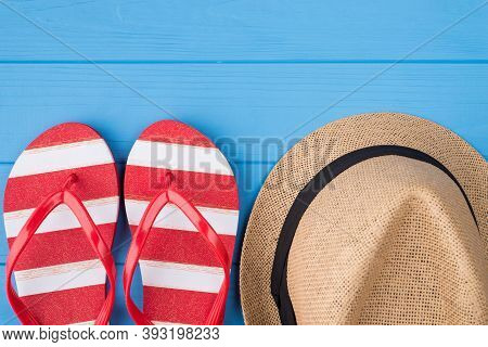 Summertime Relax Concept. Top Above Overhead View Photo Of Striped Flipflops And Hat Isolated On Blu