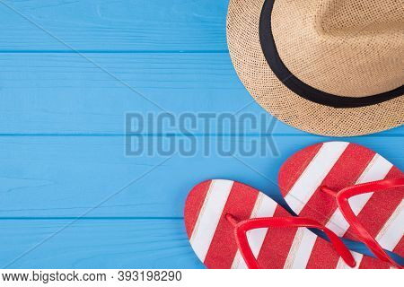 Vacation Time Concept. Top Above Overhead View Photo Of Striped Flipflops And Hat Isolated On Blue W