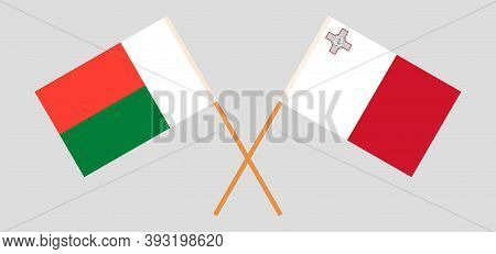 Crossed Flags Of Madagascar And Malta. Official Colors. Correct Proportion. Vector Illustration